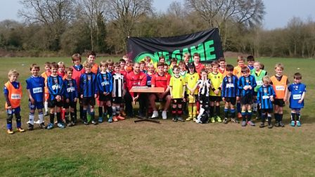 Watford players Josh Doherty and Matthew Connelly with young footballers in Harpenden