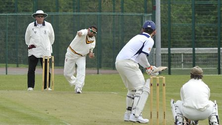 Navid Ahmed bowling for Huntingdon & District in their victory over Cambridge NCI. Picture by Helen
