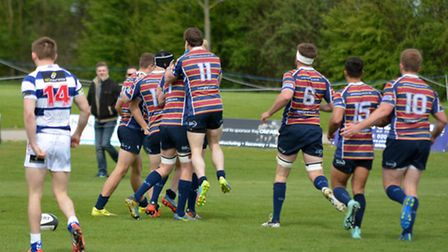 Players celebrate the first try