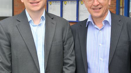 Father and son local councillors Sam and Anthony Rowlands outside the council offices after Sam was