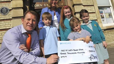 Mick George financial director, John Stump, left, with Elliot, Grace, Freya, Sophie, and book jam or