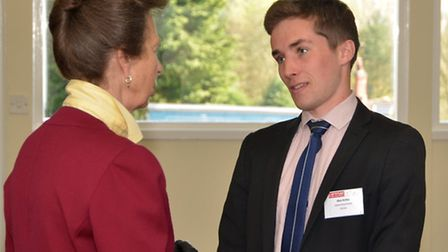 Former Verulam School pupil Alex Astley is presented with the Adrian Evans award by The Princess Roy