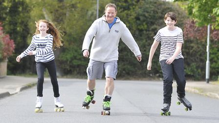At their home in Little Paxton, are (l-r) Kayleigh, dad Ian, and Christohper Rhodes-Elson, who are d