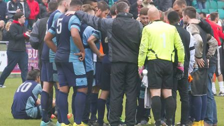 St Neots players and management in a post-match huddle at Truro. Picture by Claire Howes.