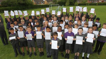 Cunningham School year 6 pupils with their letters to cllr Julian Daly at the district council suppo