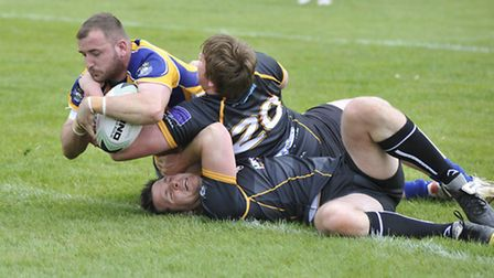 Aaron Thorne scores a try for St Ives Roosters in their season-opening success against Bedford Tiger