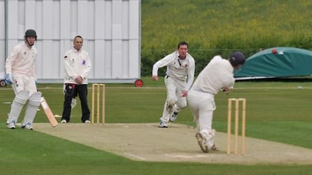 James Heslam hits a Rob Laney delivery up in the air
