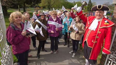 The ladies celebrating 100 years of the WI with the Royston town crier. PICTURE: David Gray.