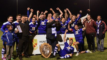 Godmanchester Rovers celebrate their Hunts Senior Cup success.