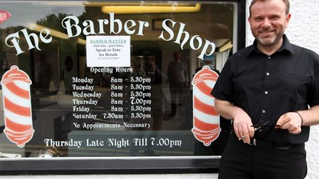 Tony Perretta, owner of The Barber Shop is having his beard shaved off for Bloomsday