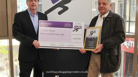 Maltings centre manager Philip Corrigan presents a cheque to Colin Bower for this months St Albans c