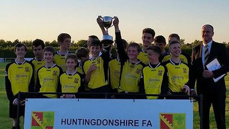 The Priory Parkside Black Under 14 team celebrate their Hunts Cup success.