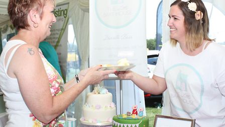 Danielle Bass serves food from her Little Bake House stand, which won first prize for the best trade
