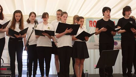 A section of the 70 strong members of the Meridian School chamber Choir played topical pieces relat