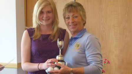 Chloe Neal (left) receives the Handicap Cup prize, won at the Cambs & Hunts Junior Girls Championshi