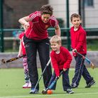 Hannah Macleod gives some coaching tips to youngsters at St Albans' club day. Picture: Chris Hobson