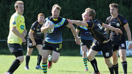 Rob Holbrook makes a break through the Bedford defence. Picture: Darryl Brown