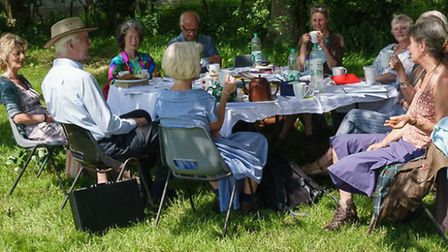 People taking part in an outdoors creative writing workshop run by Open Ground, who are also going t