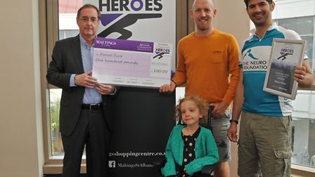 Manager of The Maltings Shopping Centre Phil Corrigan presents the community heroes award to David O