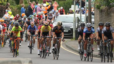 The chasing pack head up Barkway Road in Royston during the fourth stage of the Aviva Women's Tour.