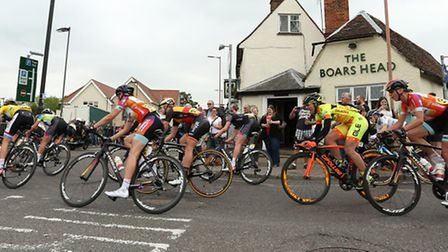 The peleton make the turn outside The Boars Head pub in Royston during the Aviva Women's Tour. Pictu