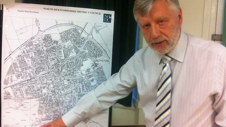 Councillor Peter Burt with a map of the town.