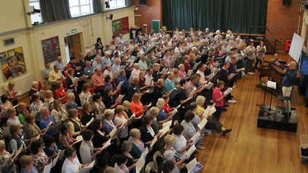 World renowned British composer John Rutter leads a singing day for local choirs organised by the Le