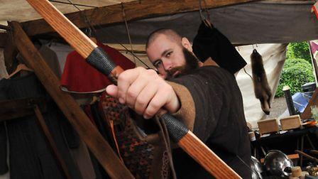 """Agnar of """"The gripping beast"""" with a longbow on a stall at the medieval market, part of the 800th an"""