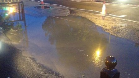 The flooding after a sewer in High Street in London Colney overflowed