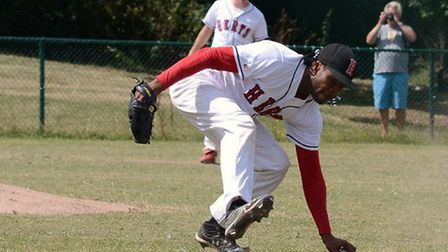 Pitcher Jose Sosa scoops up a ground ball. Picture: Paul Holdrick
