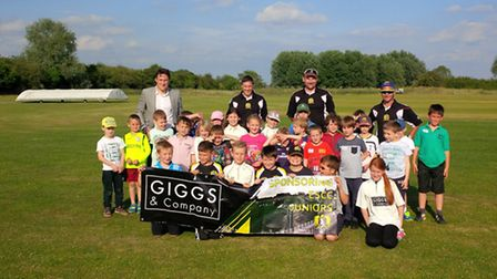 Youngsters attending Eaton Socon Cricket Club's Friday fun junior sessions are pictured with back ro
