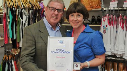 """Cancer Research UK area manager John Egan presents Caroline Jones with a special commendation for """"P"""