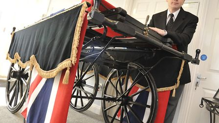 Hand drawn hearse on display, at Co-operative Funeral Services, Huntingdon, with Funeral Director Br