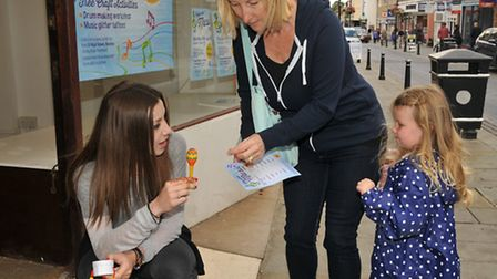 A family stop to try out the music trail in all the shops of Royston High Street