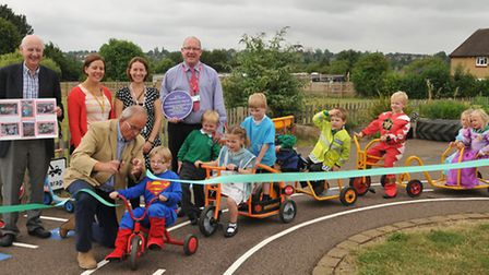 Reception children from Sauncey Wood school enjoy their new playground ofiicially opened by chairman