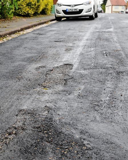 The messy resurfacing job done on Abbey View Road