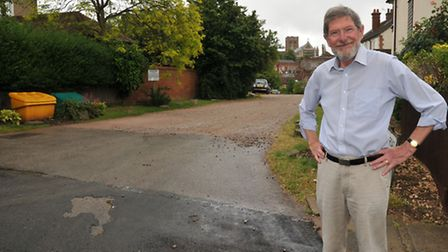 Local resident Chris Rolfe is unhappy with the rushed resurfacing job done on Abbey View Road which