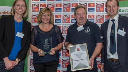 Wheathampstead Wanderers' Andy Ellis and Tracey Devine with Faye White, left, and Hertfordshire FA C