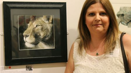 Angela Smith with her picture, African Queen.