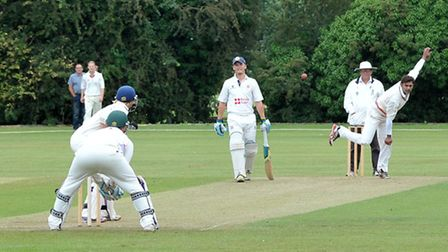 Tariq Aziz bowling for Godmanchester in their top-of-the-table triumph at Wisbech on Saturday. Pictu