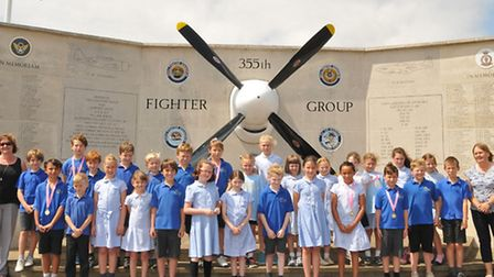 Steeple Morden church of England year 4 class at the memorial to the 355th fighter group which was e