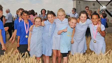 Steeple Morden church of England year 4 class wait for the fly past of two A-10C Thunderbolt II at t