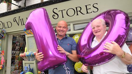 Village store owner David Hearn and former owner Eric Darby celebrate 10 years of David taking over