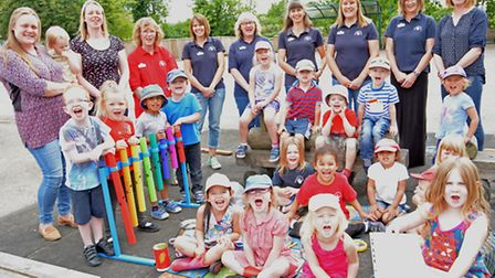 Needingworth Pre-School good Ofsted report, staff and children, in the playground,