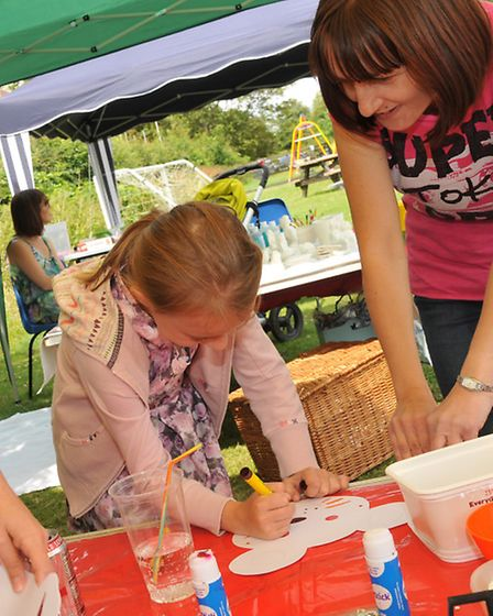 Children make masks at the Barkway park family festival