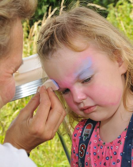 Daisymay Morrison, 3 has her face painted at the Barkway park family festival
