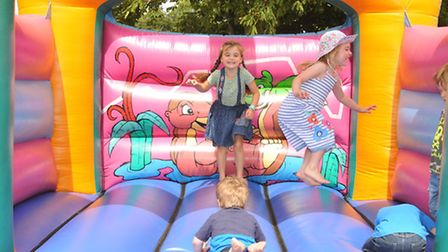Children enoy the bouncy castle at the Barkway park family festival