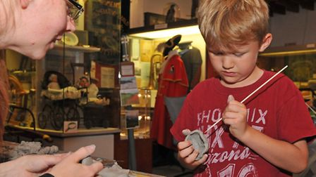 Joshua Plews, 6 makes some clay pottery during stone-age day at Royston museum