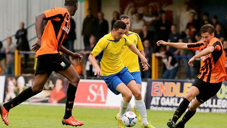 Luke Allen looks for away through the Barnet defense. Picture: Leigh Page