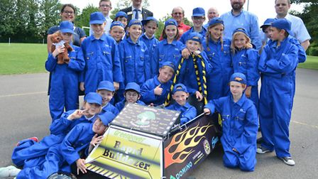 Pupils from Newton Primary School, Eltisley, with their race car they have built, with help from St